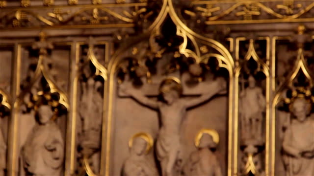 Pull Focus Blur of Marble Jesus Sculpture on Altar in Church - Religious Art Beautiful Backgrounds video
