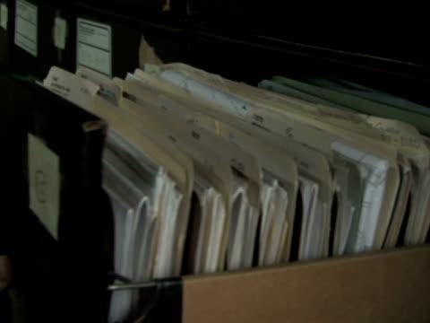 ファイルキャビネットの引き出しから - ファイル点の映像素材/bロール