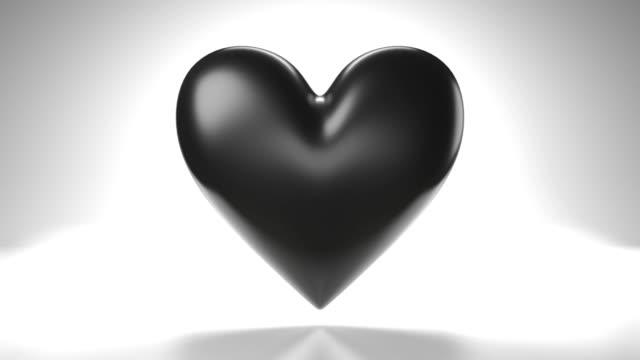 Pulserend zwart hartvormvoorwerp op witte achtergrond. Loop staat 3D-animatie. video