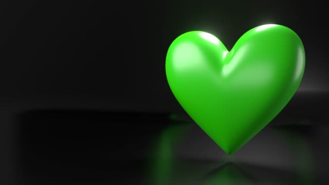 Pulserend groen hartvormvoorwerp op zwarte tekstruimte. video
