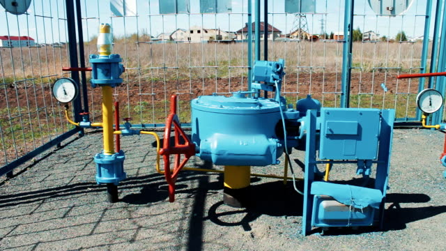 Pump station for pumping gas. Supply of natural gas to the public. Profitable business. Oil and gas industry. Production of fuel from natural resources. Pipeline with pressure gauges and a shut-off valve video