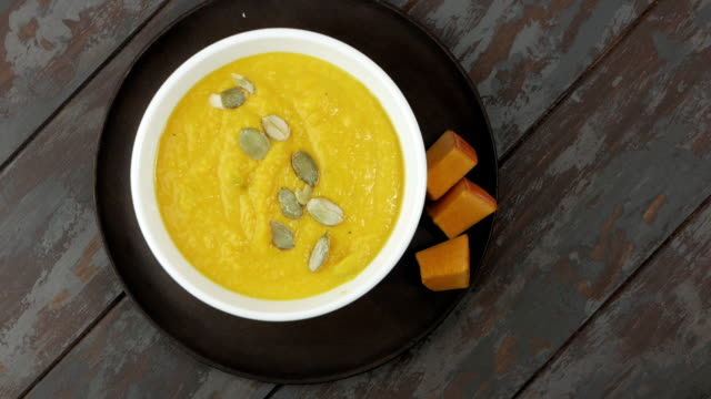 pumpkin cream soup with pumpkin seeds - thanksgiving background stock videos & royalty-free footage