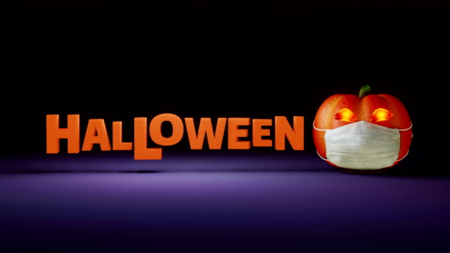 Pumpkin in white mask rolls in and reveals the word Halloween. Animation of orange pumpkin and the Halloween word. halloween covid stock videos & royalty-free footage