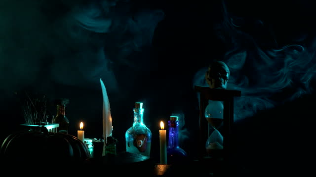 Pumpkin, Poison Bottle, Dead Insects, Candles, Human Skull and Magic Book For Halloween video