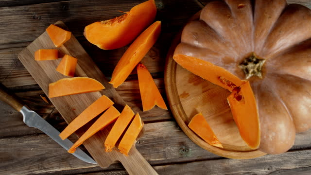 Pumpkin slices on cutting Board slowly rotate.
