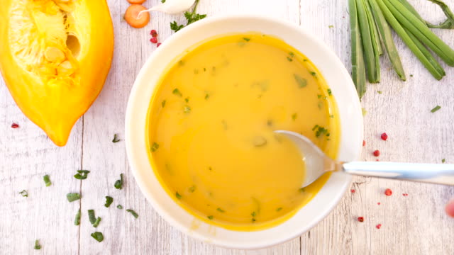pumpkin soup with vegetable and spoon