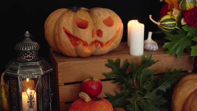 Pumpkins, candles and other attributes of Halloween holiday