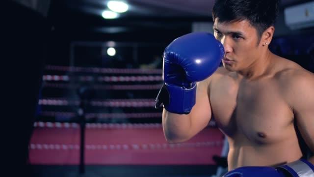 Punching bag workout,Video slow-motion. video