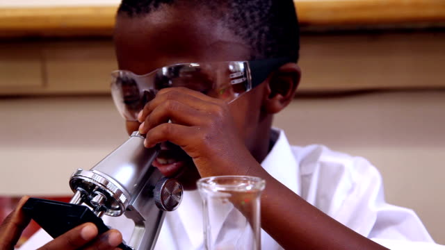 Pupil looking through microscope video