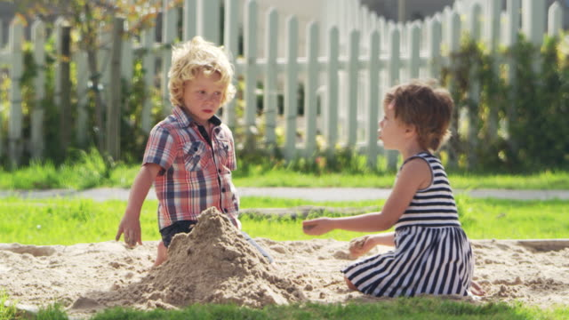 Pupils At Montessori School Playing In Sand Pit At Breaktime video