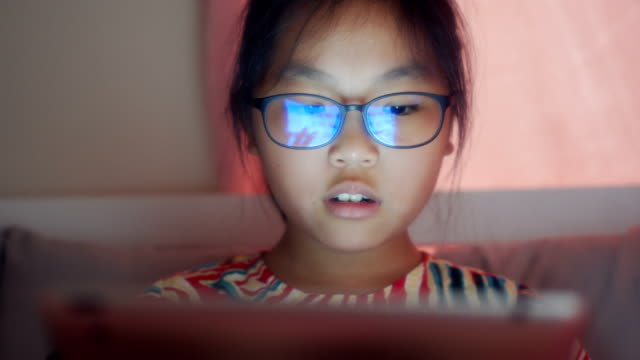 pupils using  digital table pc on bed - 8 9 anni video stock e b–roll