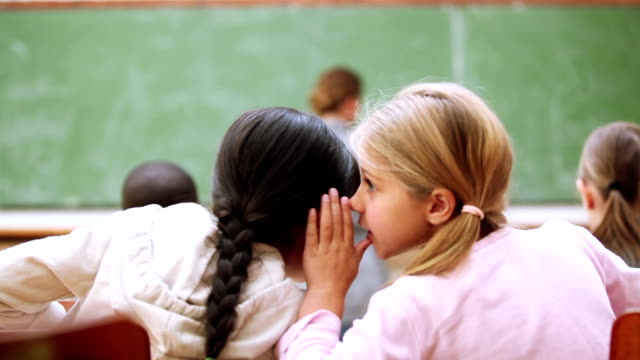 Pupils whispering secrets video