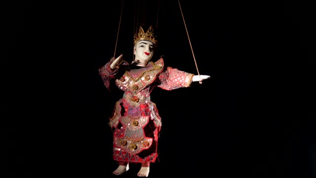 puppet dancing on black background This video shows a beautiful vintage hun lakhon lek puppet dancing while being hung on it's strings, against a black background marionette stock videos & royalty-free footage