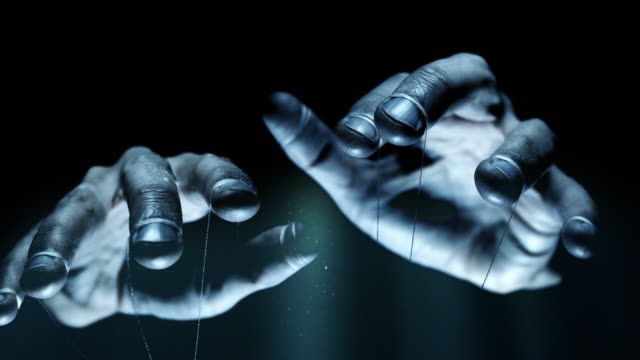 Puppet hands from leadership controlling our lives. Concept We are being manipulated concept. Large scary hands with puppet string tied around fingers marionette stock videos & royalty-free footage
