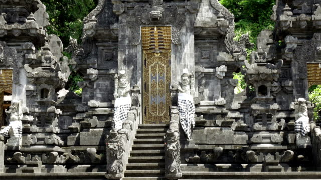 Pura Goa Lawah (bat cave temple). The temple is built surrounding a limestone cave that housed thousands of bats. East Bali. Indonesia, video