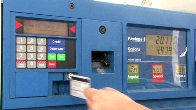 Purchasing Gas Swiping a credit card at a gas station refueling stock videos & royalty-free footage