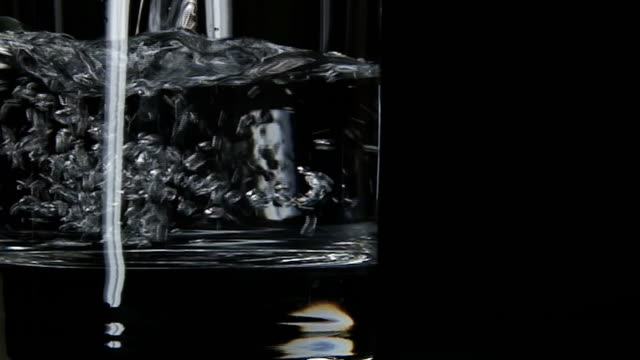 Pure, still water pouring in glass Pure, still water pouring in glass. Shot 240 fps on SONY HDR AX-2000E. Shutter speed 1/215. Lockdown. Negative Gain -6db. Cinegamma curve. There is enough room for beautiful graphic and text. Footage is unprocessed and ready for Grading and Color Correction. double refraction stock videos & royalty-free footage