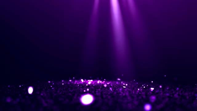 purple abstract glittering particles with spotlights background video - riflettore lenticolare video stock e b–roll