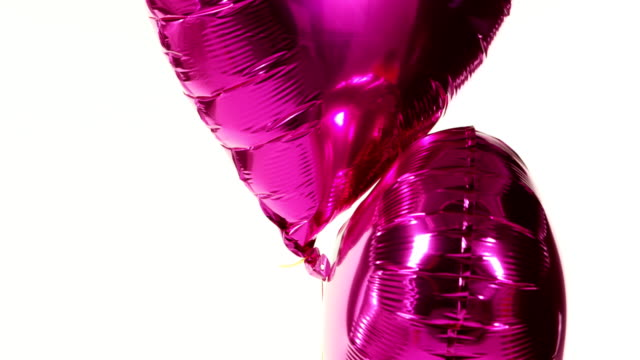 purple balloons floating in the air 4k - simbolo concettuale video stock e b–roll