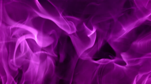 SLO MO Purple fire Slow motion close up shot of purple fire flames on a black background. purple stock videos & royalty-free footage