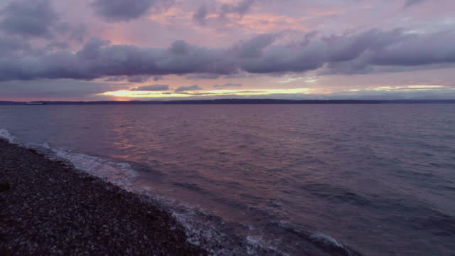 Purple Glowing Sunset at Golden Gardens Seattle Washington video