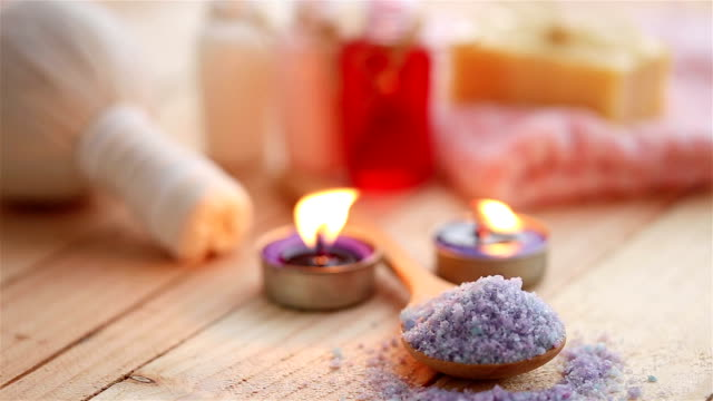 Purple lighted candles in a Spa center. video