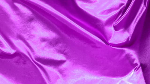 Purple satin fabric blowing in the wind, abstract background video
