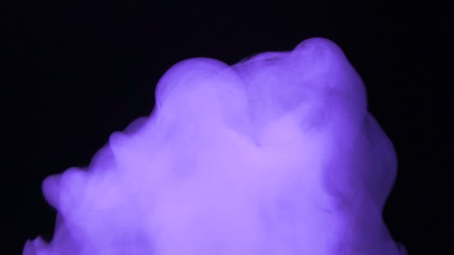 Purple smoke on a black background. Space fog. Slow motion. The footage, the texture of the smoke. Equalizer, video effect. Research, biochemistry. Alchemy. Meditation, reflection, inspiration. Aura