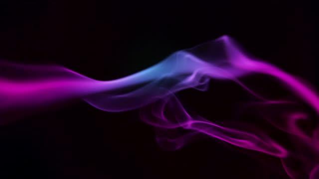 Purple smoke on a black background video