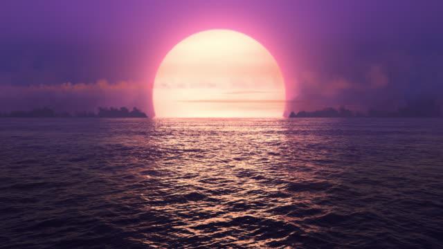 lila sonnenuntergang über nahtlos loop ozean. - traumhaft stock-videos und b-roll-filmmaterial