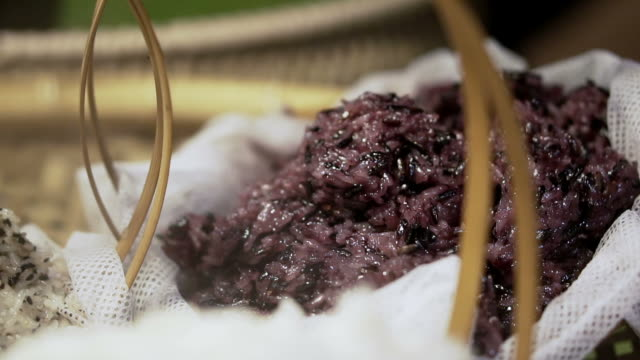 Purple, white and brown stocky rice steamed in bamboo basket video