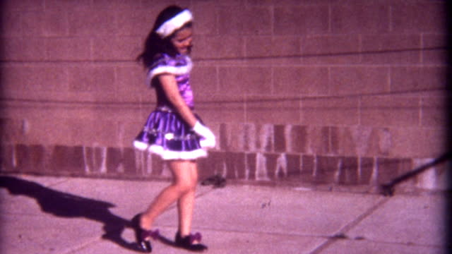 Purples Dress 1960's A young girl dances in her purple dress in the 1960's.  tapping stock videos & royalty-free footage