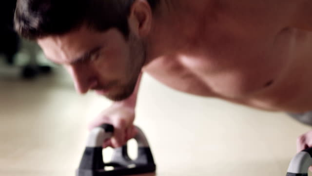 Push ups Young man exercising in gym. bodyweight training stock videos & royalty-free footage