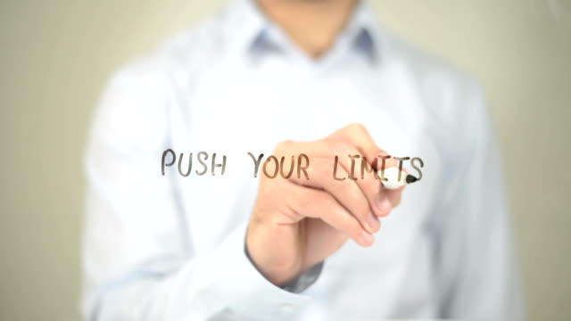 Push your Limits , Man writing on transparent screen video