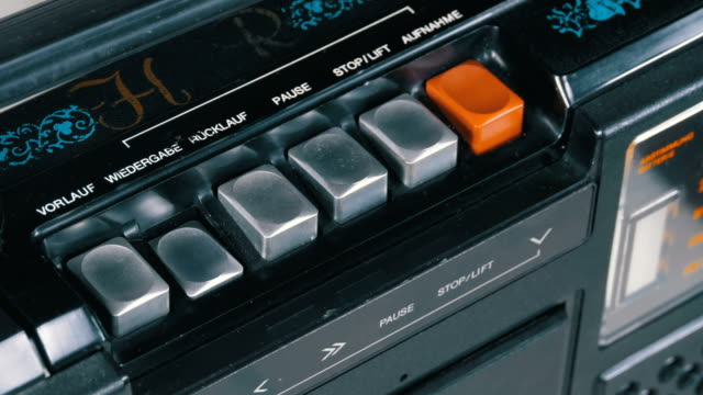 pushing button on a tape recorder, play, stop, rec, ff, rew - disco audio analogico video stock e b–roll