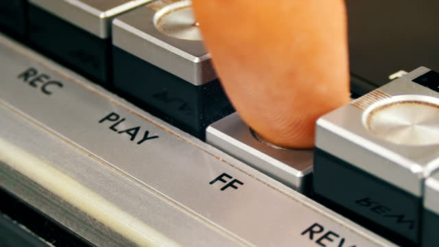 Pushing Forward Button on a Vintage Tape Recorder Pushing Forward Button on a Vintage Tape Recorder. Close-up. Pushing a Finger Button Forward. Man finger presses playback control buttons on audio cassette player. tape stock videos & royalty-free footage