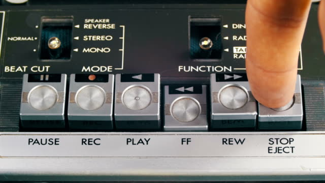Pushing Play, Stop, Forward, Rewind, Pause and Record Control Buttons on Vintage Tape Recorder video