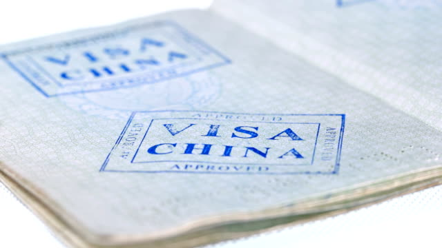 put a stamp in the passport: China visa, approved put a stamp in the passport: China visa, approved, close-up 4K schengen agreement stock videos & royalty-free footage