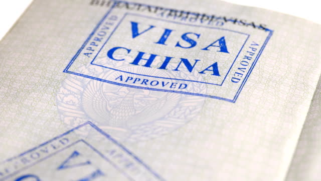 put a stamp in the passport: China visa, canceled put a stamp in the passport: China visa, canceled, close-up 4K schengen agreement stock videos & royalty-free footage
