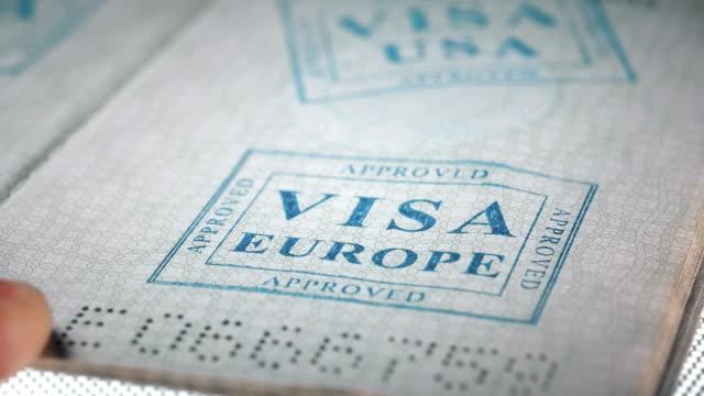 put a stamp in the passport: Europe visa, approved put a stamp in the passport: Europe visa, approved, close-up 4K schengen agreement stock videos & royalty-free footage