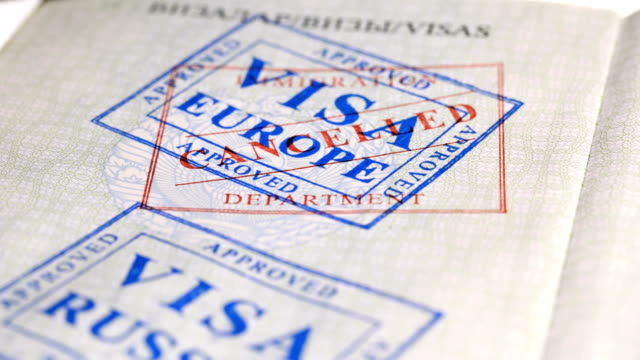 put a stamp in the passport: Europe visa, canceled put a stamp in the passport: Europe visa, canceled, close-up 4K schengen agreement stock videos & royalty-free footage