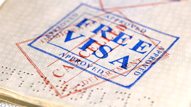 put a stamp in the passport: Free visa, canceled put a stamp in the passport: Free visa, canceled, close-up 4K schengen agreement stock videos & royalty-free footage