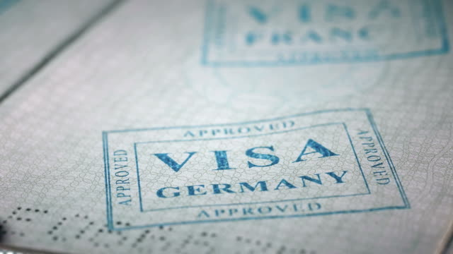 put a stamp in the passport: Germany visa, approved put a stamp in the passport: Germany visa, approved, close-up 4K schengen agreement stock videos & royalty-free footage