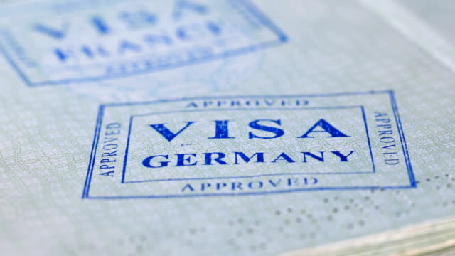 put a stamp in the passport: Germany visa, approved put a stamp in the passport: France visa, approved, close-up 4Kput a stamp in the passport: Germany visa, approved, close-up 4K schengen agreement stock videos & royalty-free footage
