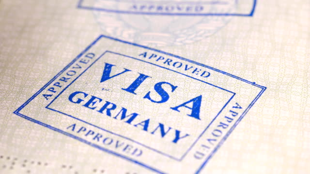 put a stamp in the passport: Germany visa, canceled put a stamp in the passport: Germany visa, canceled, close-up 4K schengen agreement stock videos & royalty-free footage