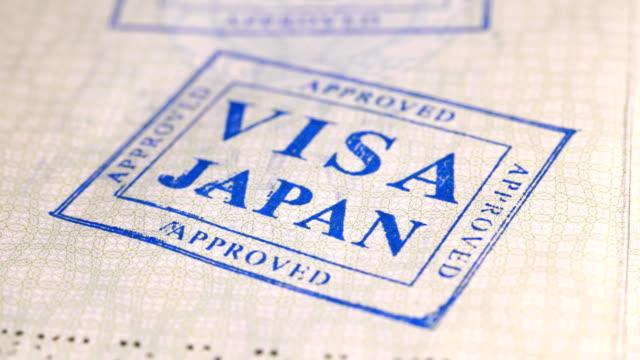 put a stamp in the passport: Japan visa, canceled put a stamp in the passport: Japan visa, canceled, close-up 4K schengen agreement stock videos & royalty-free footage