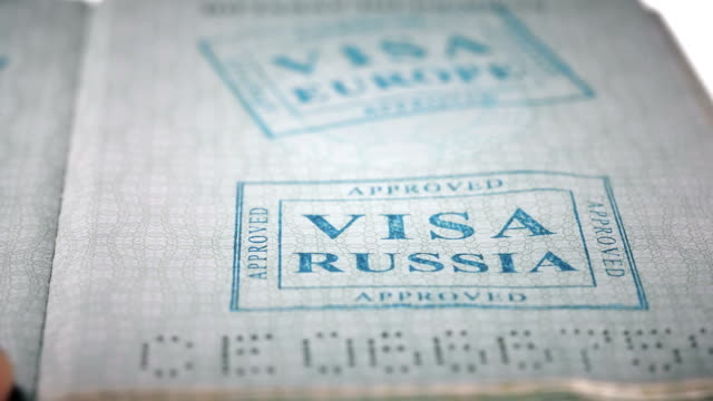 put a stamp in the passport: Russia visa, approved put a stamp in the passport: Russia visa, approved, close-up 4K schengen agreement stock videos & royalty-free footage