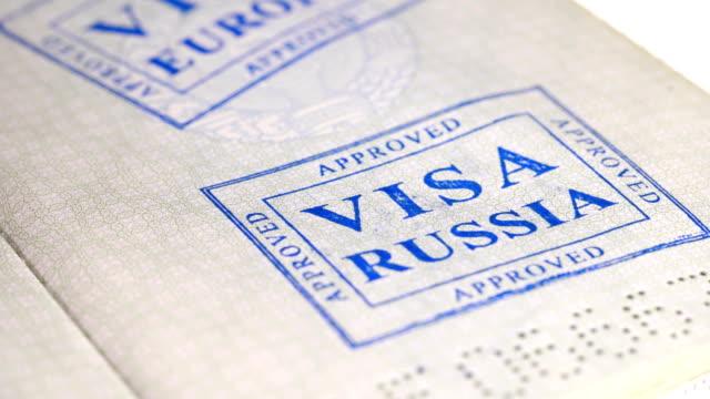 put a stamp in the passport: Russia visa, canceled put a stamp in the passport: Russia visa, canceled, close-up 4K schengen agreement stock videos & royalty-free footage