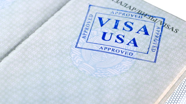 put a stamp in the passport: USA visa, approved put a stamp in the passport: USA visa, approved, close-up 4K schengen agreement stock videos & royalty-free footage