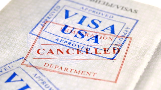 put a stamp in the passport: usa visa, canceled - passports and visas stock videos and b-roll footage